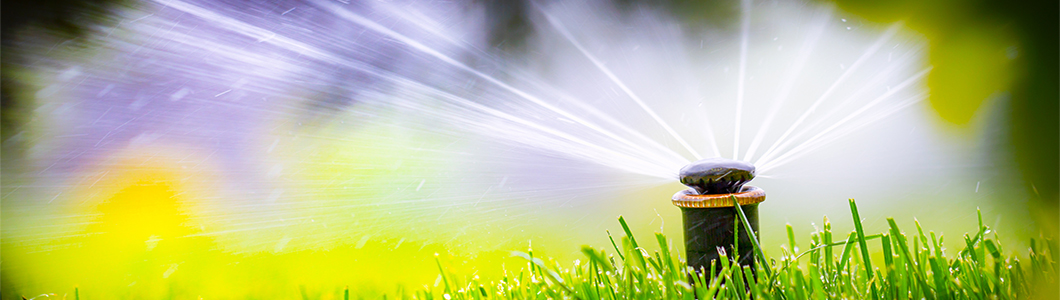 Automatic sprinkler system watering lawn